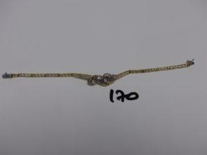 1 bracelet en or bicolore à décor floral et orné de pierres (L20cm). PB 12,5g