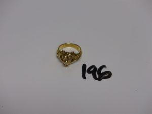 1 bague tête de lion en or dont la machoire est ornée d'1 petit diamant (Td55). PB 13,5g