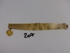 1 bracelet maille tressée en or (1 peu abimé) ornée d'1 breloque serti-griffes 1 pièce de 4 florins (L18cm). PB 46,7g