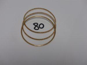 3 bracelets joncs en or (2 torsadés, diamètre 6,5cm). PB 32,8g