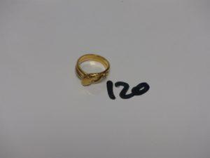 1 bague en or à décor d'1 serpent dont la tête est ornée d'1 petite pierre (Td50). PB 5,7g