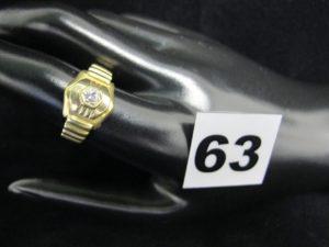 1 bague en or ornée d'une pierre blanche sur monture fantaisie (TD 56). PB 6,5g