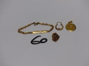 1 bris d'or, 1 médaille en or, 1 bracelet gourmette en or identité gravée et 1 petite créole en or. PB 6,7g