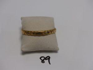 1 bracelet rigide en or motif intèrieur cable de résine noire usée (diamètre 6,5cm). PB 32,7g
