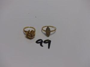 1 bague en or ornée d'1 pierre rouge et de petits diamants (Td48) et 1 petite bague marquise en or ornée de petits diamants (Td57). PB 5,6g
