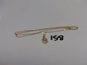 1 chaîne maille gourmette en or (L56cm) et 1 pendentif en or orné de 3 petites pierres. PB 5,4g
