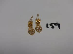 1 paire de pendants en or ornée de 3 petites pierres. PB 5,9g