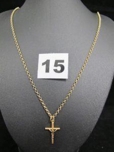 1 Chaine maille jaseron en alliage 585/1000 (14k L 62cm) PB 2,9g, et un christ sur croix en or (L 2,4cm). PB 0,6g