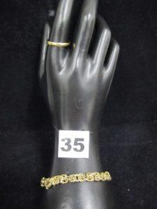 1 Bracelet maille royale (L 20cm, abimé, maillons cassés) et 1 alliance (TD 60). Le tout en or . PB 12,7g