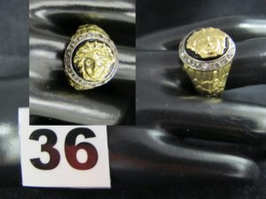 1 Bague en or bicolore dans le style de Versace (Medusa, TD 57). PB 14,5g