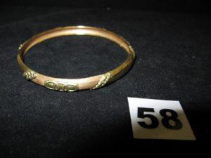 1 Bracelet rigide bicolore en or à motif points et cercles granités (Diam 7cm). PB 10,1g