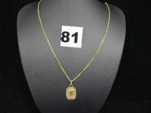 1 chaine maille forçat (L 22cm) et 1 médaille de la vierge Marie. Le tout en or. PB 5,3g