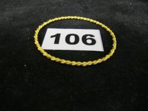 1 Bracelet 22k pour enfant, rigide, torsadé, (Diam 5,3cm, tordu). PB 8,3g