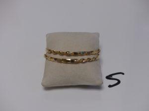 2 bracelets rigides ciselés en or (diamètre 6cm). PB 29,7g