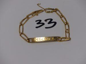 1 bracelet gourmette en or gravé Michel , fermoir orné d'une petite pierre bleue (L24cm, sécurité cassée). PB 17,2g