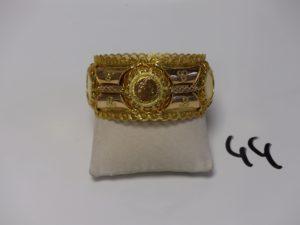 1 bracelet esclave en or à motifs ouvragés et filigranés (diamètre 7cm, 1 peu cabossé). PB 72g