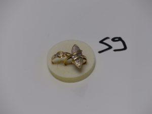 2 bagues en or (1 ornée de 2 petits diamants td58 et 1 marquise ornée de petits diamant monture à redresser td59). PB 6,7g