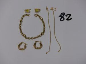 1 bracelet maille jaseron rehaussé de 4 boules (L16cm), 2 pendants à décor de petites boules, 2 créoles torsadées et 2 boucles à décor d'un papillon émaillé entouré de petites pierres. Le tout en or PB 9,4g