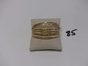7 Bracelets rigides ciselés en or (diamètre 6cm). PB 39,1g