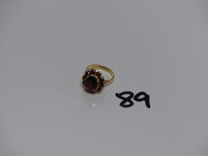 1 bague en or rehaussée de pierres couleur grenat (td56). PB 5,1g