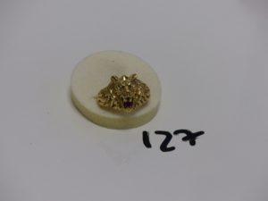 1 bague en or à décor d'un lion dont la machoire est ornée d'une pierre rouge (td63). PB 14,3g