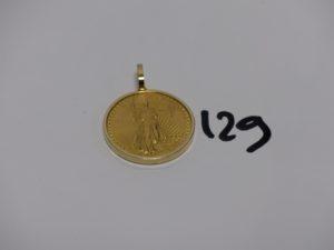 1 pendentif en alliage 14K, serti-griffes 1 pièce de 20 Dollars St Gauden 1927 (belière en or 18K). PB 38,1g