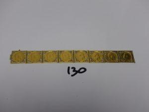 1 bracelet maille articulée en or, serti de 8 demi-Souverains en or (L19cm, fermoir à vis cassé). PB 57,5g