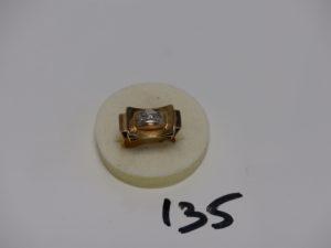1 bague tank en or et platine ornée de 3 petits diamants (td55). PB 7,5g