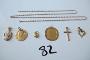 2 Médailles en or(1 à décor de la vierge,1 gravée),1 croix en or ciselée,1 chaine en or brisée,3 pendentifs en or (1 à décor d'un camée,2 à décor de coeurs).PB 12,1g