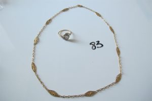 1 Collier en or maille filigranée(L46cm)1 bague 2 ors à décor de spirale rehaussée d'un petit diamant central entourage petits diamants taillés en roses(td57).PB 11,6g