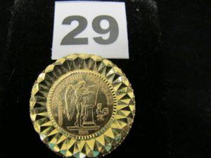 1 pendentif en or serti griffe d'une pièce de 20 Francs Génie de 1898 (attache cassée); PB : 10,3g