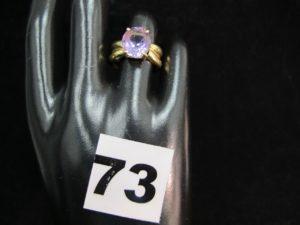 1 bague en or ornée d'une améthyste ovale (TD 53). PB : 5,7g