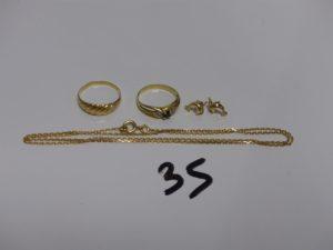 1 chaîne maille forçat en or (L44cm) 1 bague en or motif central ciselé (Td53), 1 bague en or ornée d'1 pierre bleue (Td50, 2 boucles en or à décor d'1 dauphin . PB 7,3g