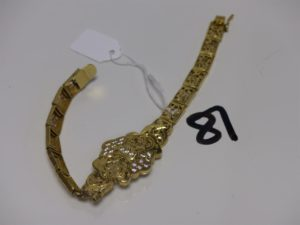 1 bracelet maille articulée en or (soudure bas titre et motifs cassés). PB 16,6g