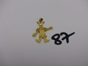 1 pendentif en or dont les membres sont articulés. PB 4,4g