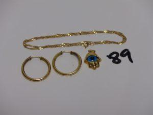 1 chaîne maille torsadée en or (L38cm) 2 créoles abîmées en or et 1 petit pendentif main en or orné d'1 oeil bleu. PB 4,6g