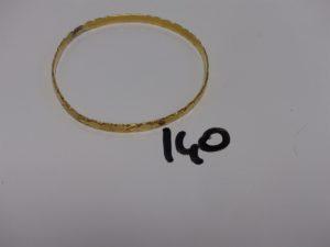 1 bracelet rigide ouvragé en or (diamètre 6,5cm). PB 12,5g