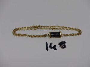 1 bracelet en or 2 rangs maille alternée ornée d'1 Tiki (L16cm,fermoir abîmé). PB 8,4g