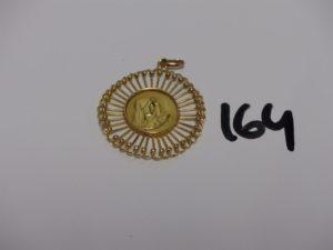 1 médaille de la Vierge en or (belière et anneau en alliage 14K). PB 8,5g