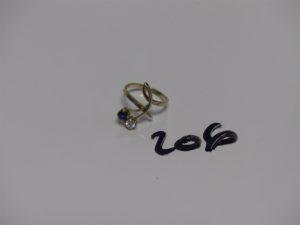1 bague en or ornée d'1 diamant d'environ 0,10 ct et d'1 pierre bleue (Td49). PB 2,5g
