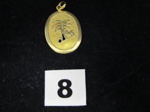 1 grand pendentif plaque ovale en or décorée d'un motif, représentant une oasis (L 4,4cm). PB 4,3g