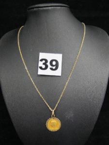 1 chaine maille forçat (L 45cm) et une médaille de la vierge. Le tout en or. PB 4,6g
