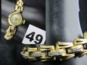 1 Montre de dame en or jaune, le bracelet serti en partie de diamants (1 chaton vide) le cadran signé AAMOR- mouvement Suisse ébauche (L 19cm). PB 31g