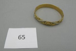 1 Bracelet 2 ors rigides à décor floral (D6,5cm).PB 47,5g.