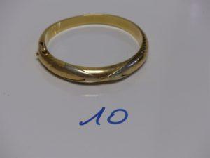 1 bracelet rigide semi-ouvrant bicolore en or (diamètre 5/6cm). PB 27,4g