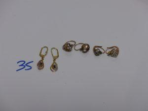 1 paire de boucles en or ornées d'une pierre, 1 boucle or et argent, 1 boucle or,argent et petit diamant Tl rose et 1 paire de pendants en or ornés d'une petite pierre bleue. PB 6,9g