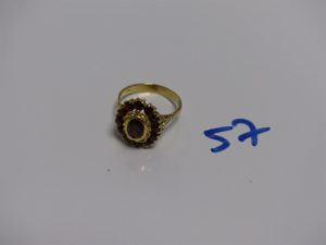 1 bague en or ornée de pierres couleur grenat (td55). PB 4,8g