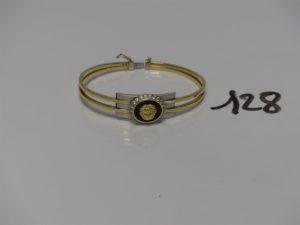 1 bracelet ouvrant motif central bicolore orné de pierres et articulé (diamètre 5/6cm). Le tout en or PB 15,4g