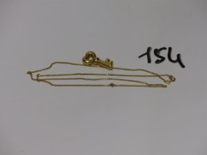 1 chaîne maille gourmette (L50cm, anneau de bout à réparer) et 1 pendentif clef. Le tout en or PB 5,7g