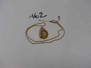 1 chaîne maille serpent (L41cm) et 1 pendentif porte-photos. Le tout en or PB 7,1g